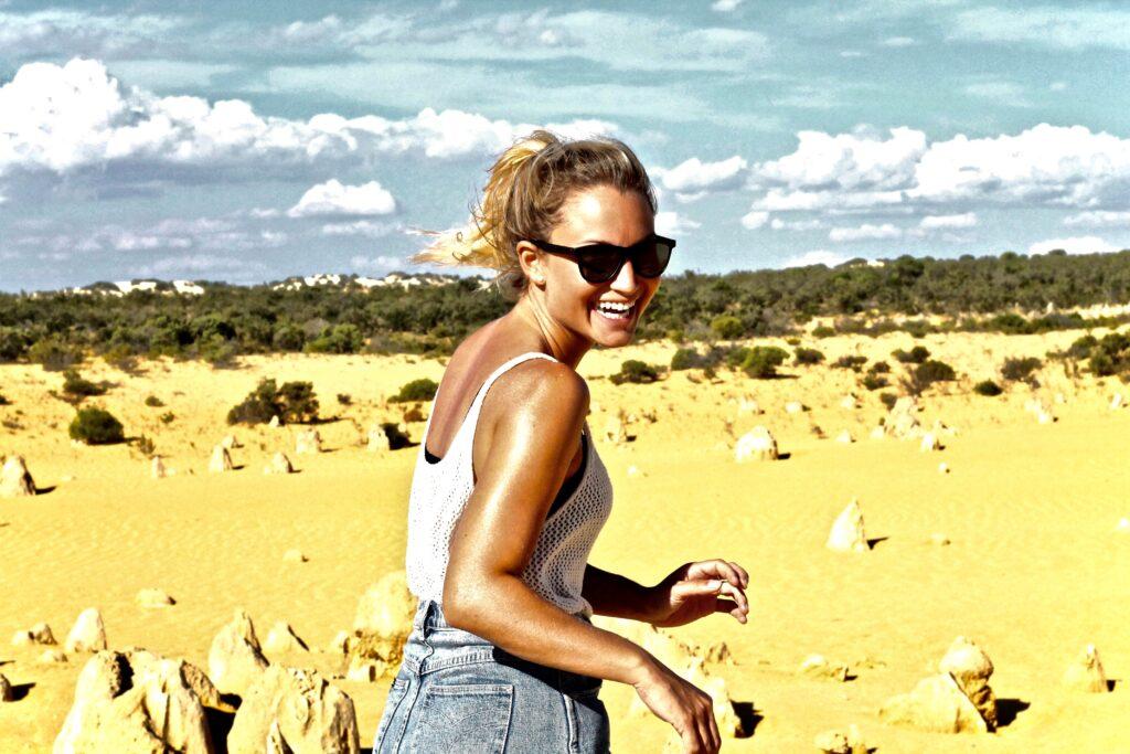 Women with white tank top in Australia