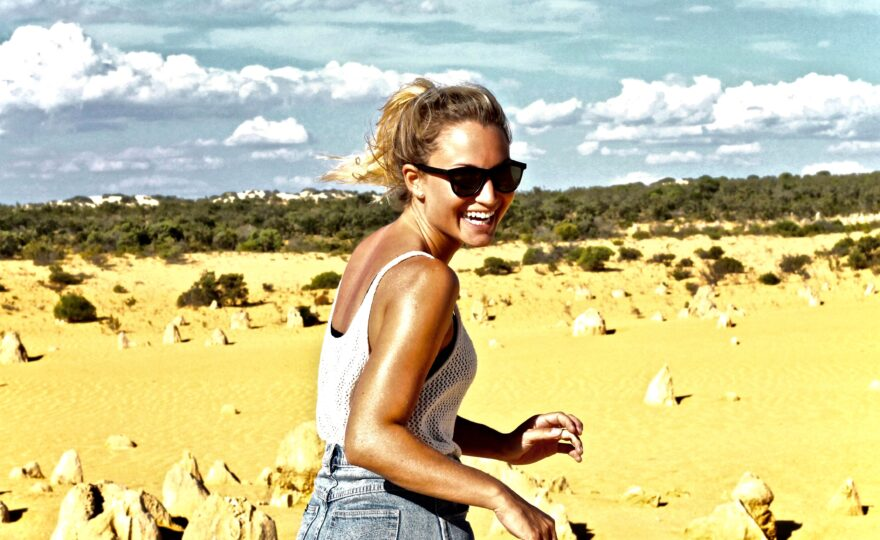 Women with white tank top in Australia